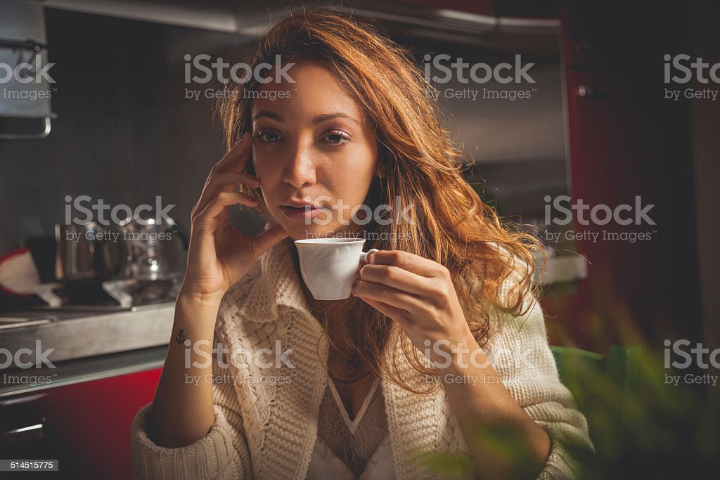 Bored woman having breakfast stock photo