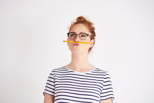 Bored woman having fun with pencil