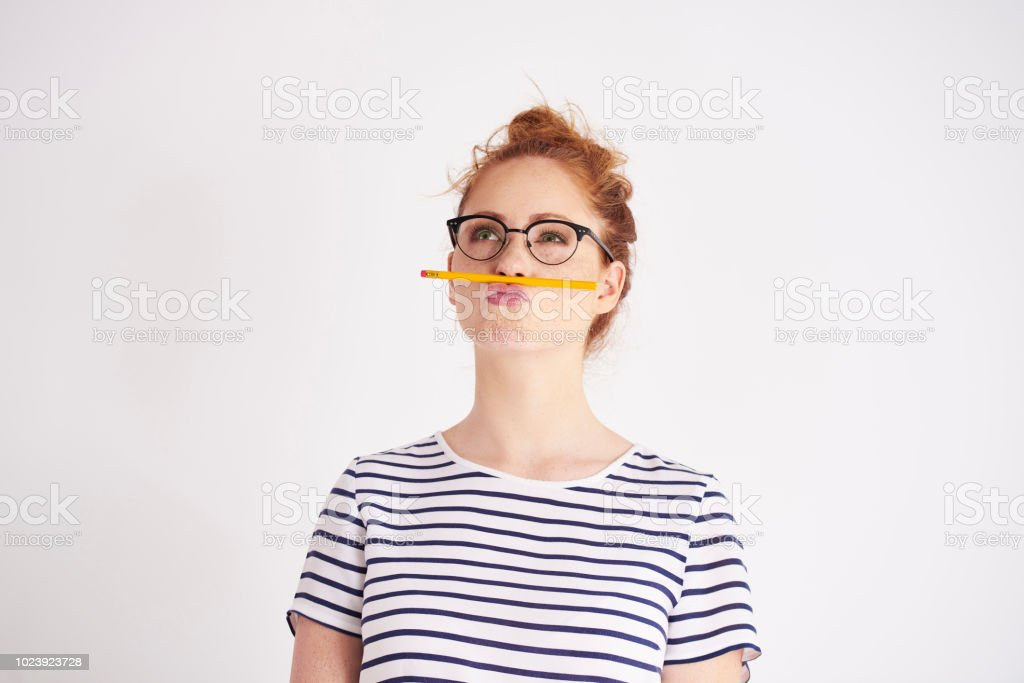 Bored woman having fun with pencil stock photo