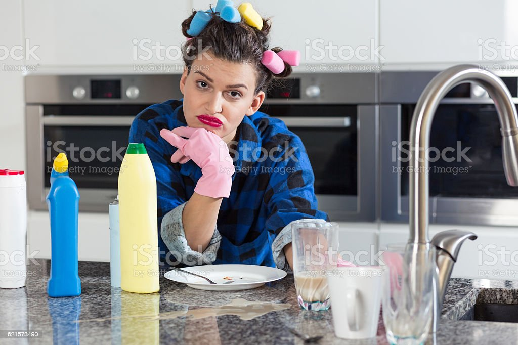 Bored woman in a  kitchen photo libre de droits