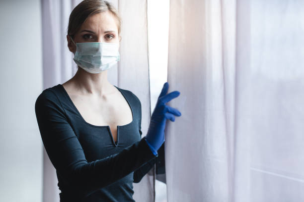 Bored woman in corona quarantine or under curfew stock photo