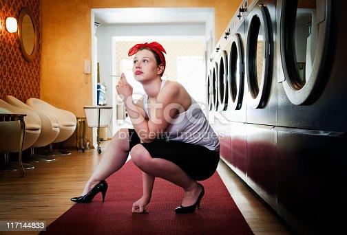 istock Bored woman in Laundromat 117144833