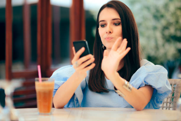 Bored Woman Swiping Men Profiles on Dating App Website Funny person looking for a date online on matrimonial social networks smart card stock pictures, royalty-free photos & images