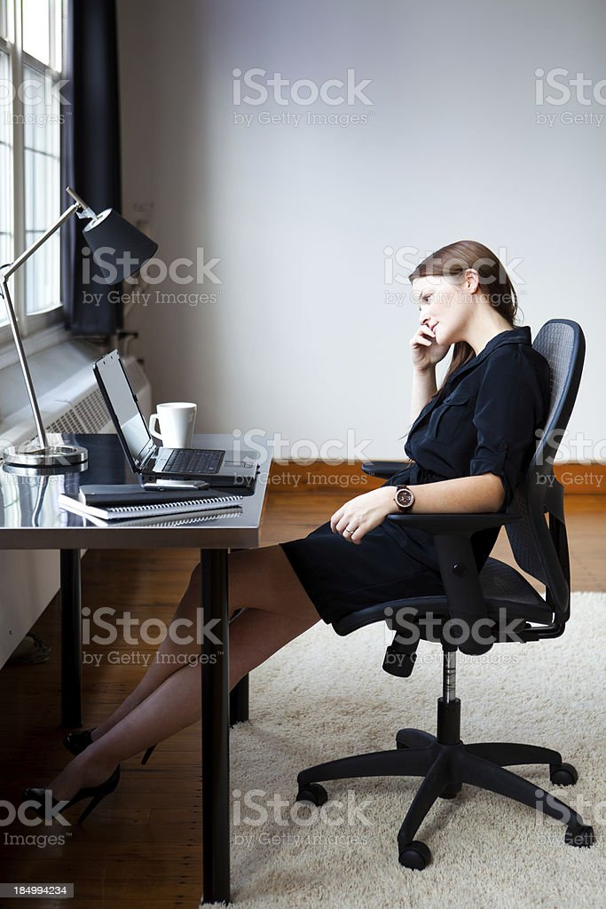 Bored young businesswoman stock photo
