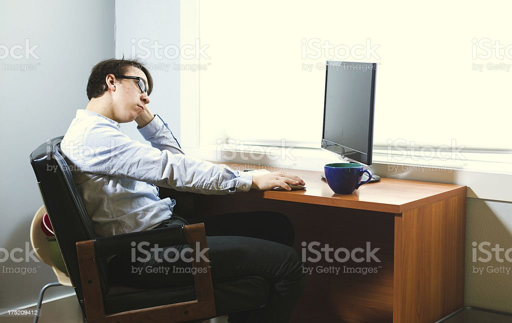 Bored Young Office Working Businessman stock photo