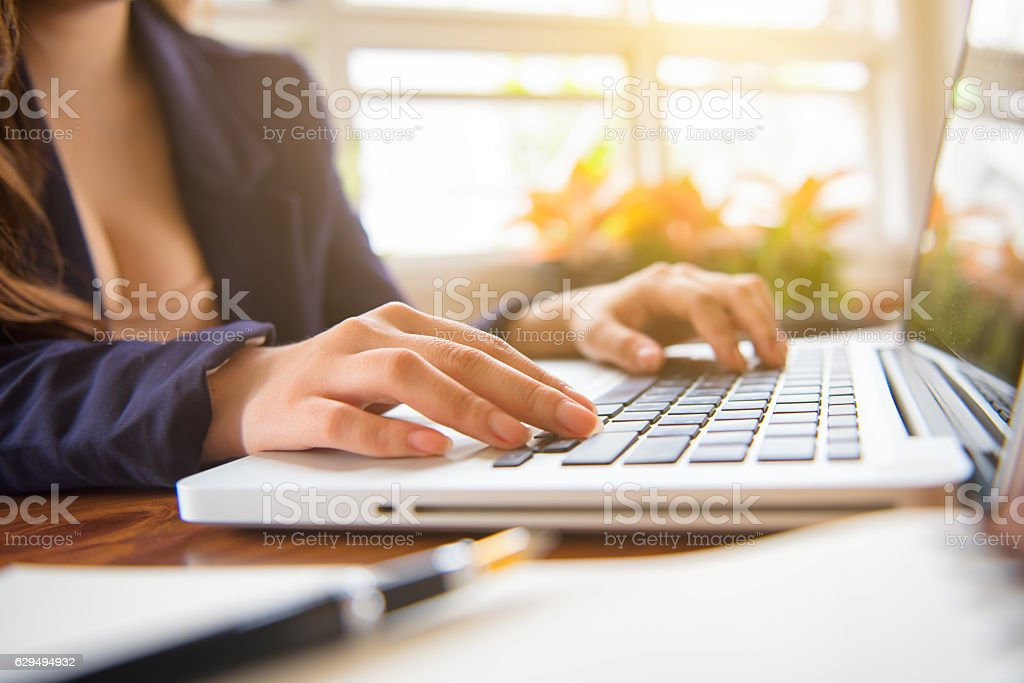 Bored young woman in the office working stock photo