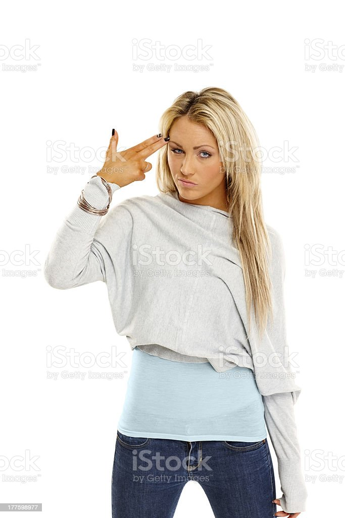 Bored young woman pretending to blow up her head royalty-free stock photo