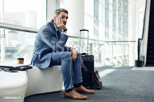 Shot of a mature businessman waiting in an airport