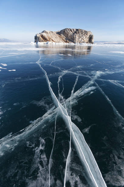 Borga-Dagan island. Cracks in ice of Lake Baikal, Winter landscape stock photo