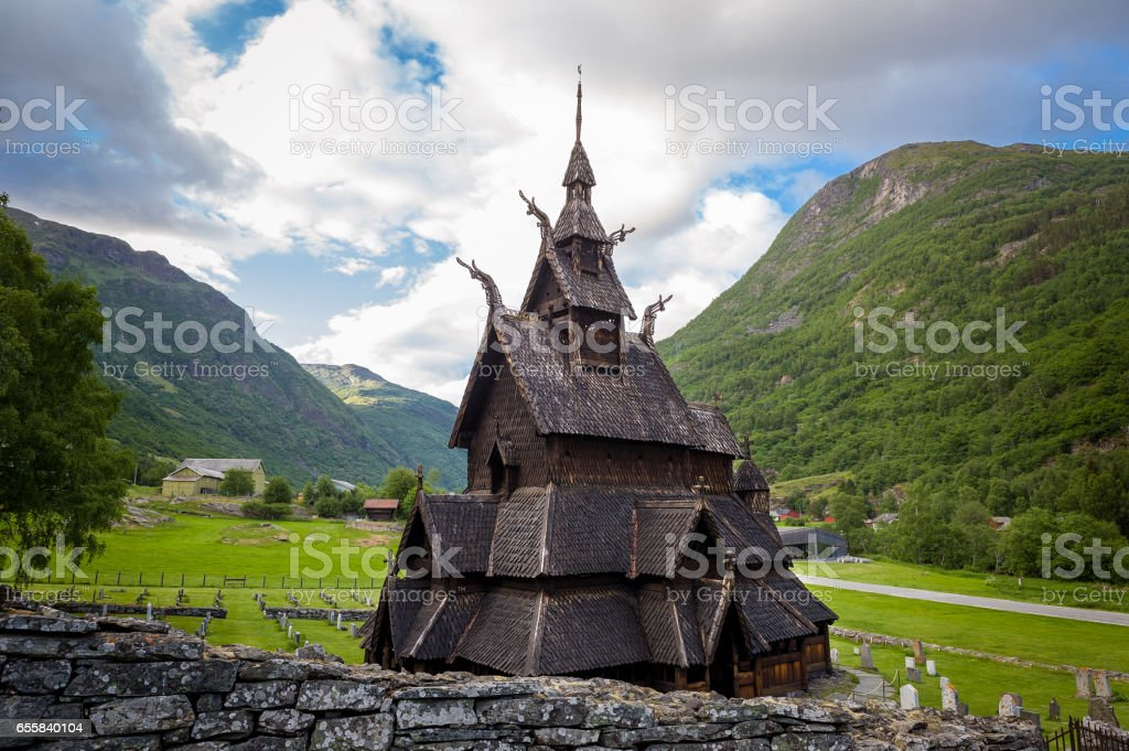 Borgund Stave Church and mountain background stock photo