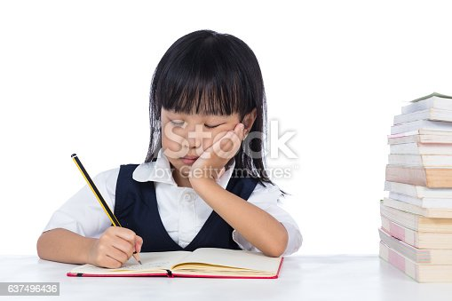 istock Boring Asian Chinese little girl wearing school uniform studying 637496436