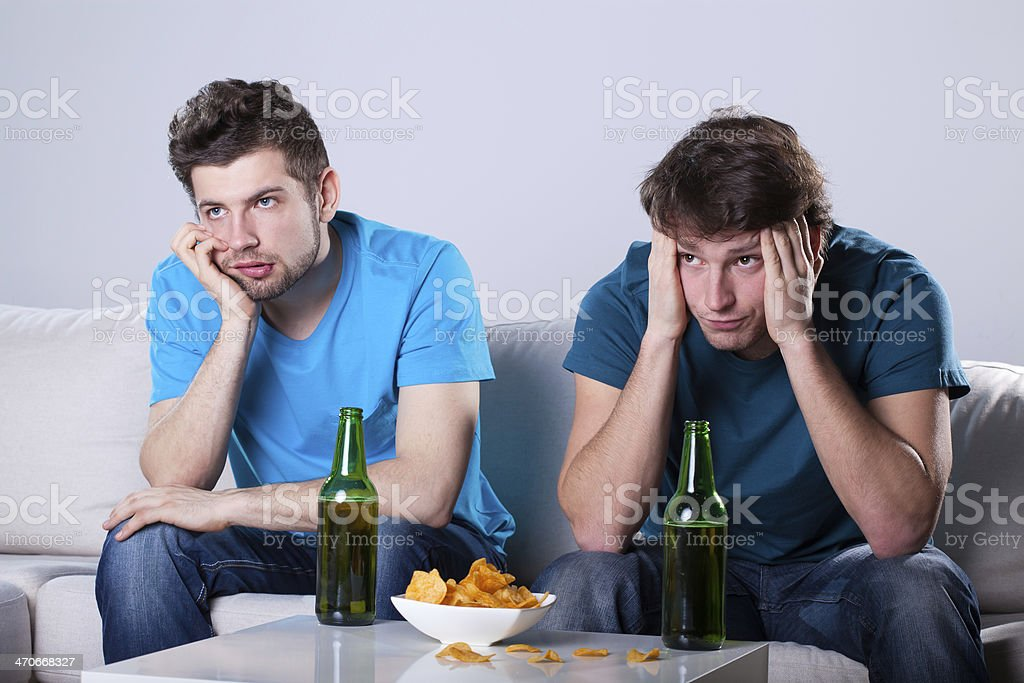 Boring beer and nachos evening stock photo