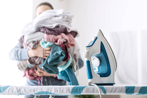 boring household chores - ironing stock photos and pictures