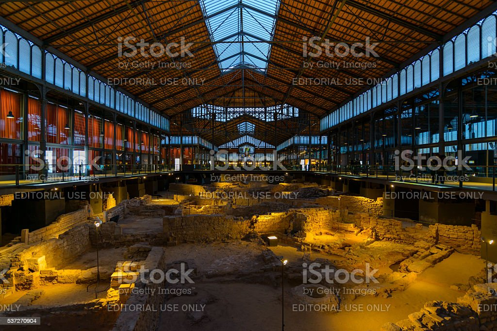 Born Cultural Centre Barcelona, Spain - January 5, 2016: Born Cultural Centre Interior. This fully restored unique 19th Century market houses some of the archaeological remains of Barcelona City as it was in the 18th Century and is sometimes referred to as the City of Born and known locally as El Born CC.The excavated city ruins, dating back to the 17th Century, can be seen from the viewing balconies and there are also various exhibitions about the Siege of 1714.Barcelona, Catalonia, Spain, Europe. 2015 Stock Photo