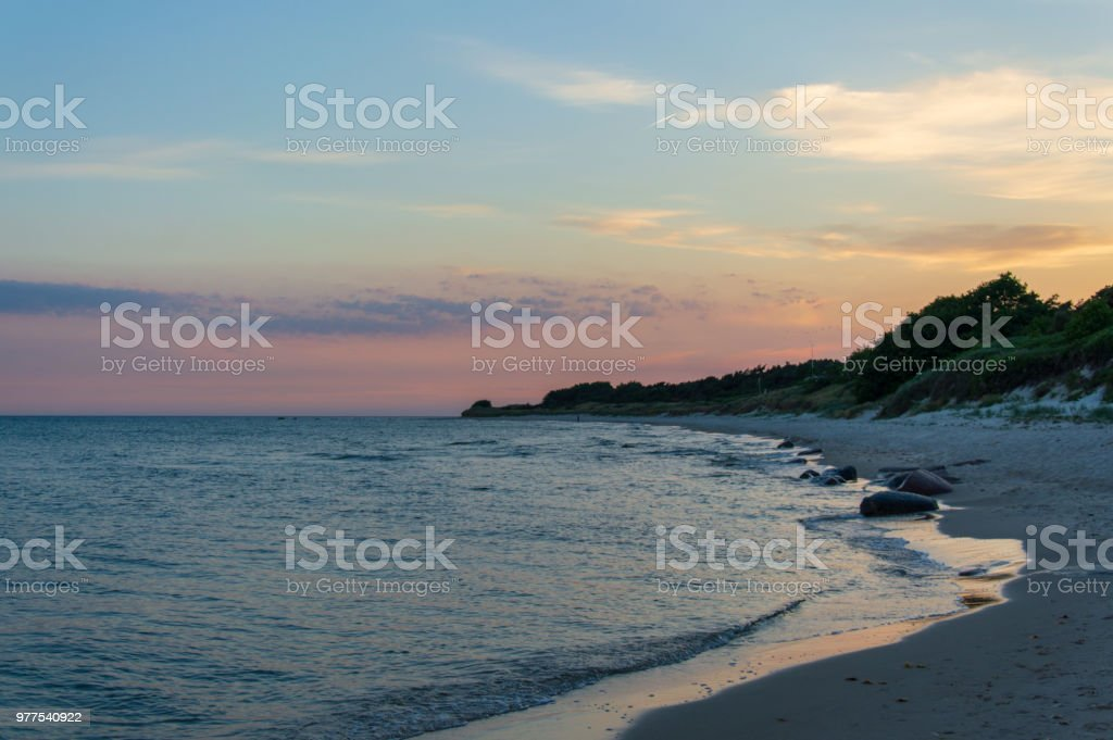 Bornholm beach with rocks in the water, Denmark, on a evening in summer stock photo