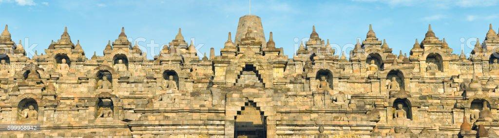 Borobudur temple top tiers facade panorama stock photo