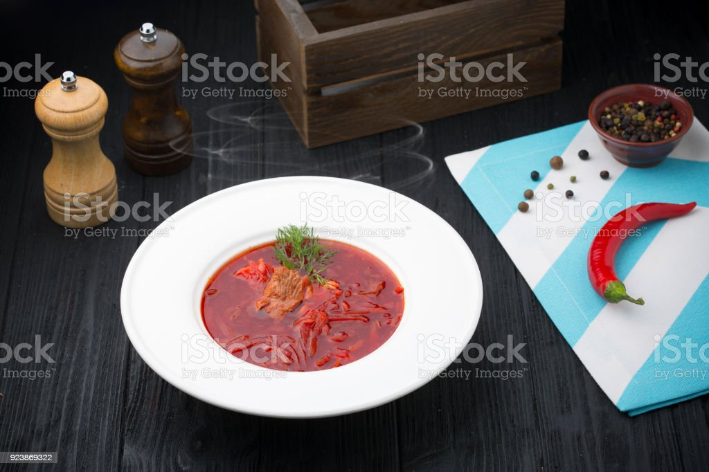 Borsch - beetroot soup on black wooden background stock photo