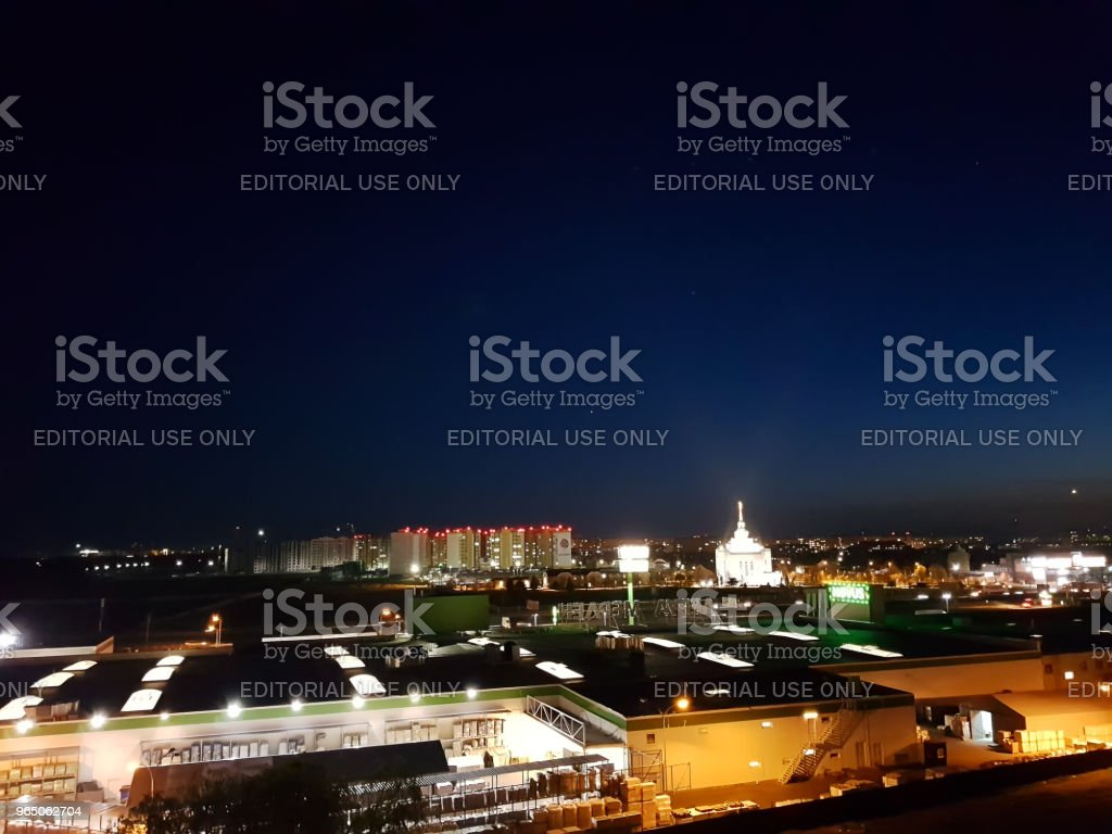 Kiev, Ukraine - May, 29: Borshchagovka district at night in lanterns, shop Novus and Leroy Merlin with a view of the church zbiór zdjęć royalty-free