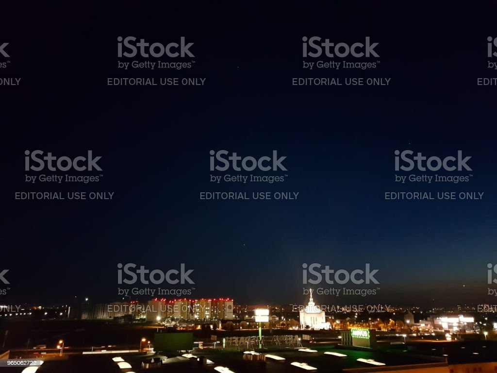 Kiev, Ukraine - May, 29: Borshchagovka district at night in lanterns, shop Novus and Leroy Merlin with a view of the church