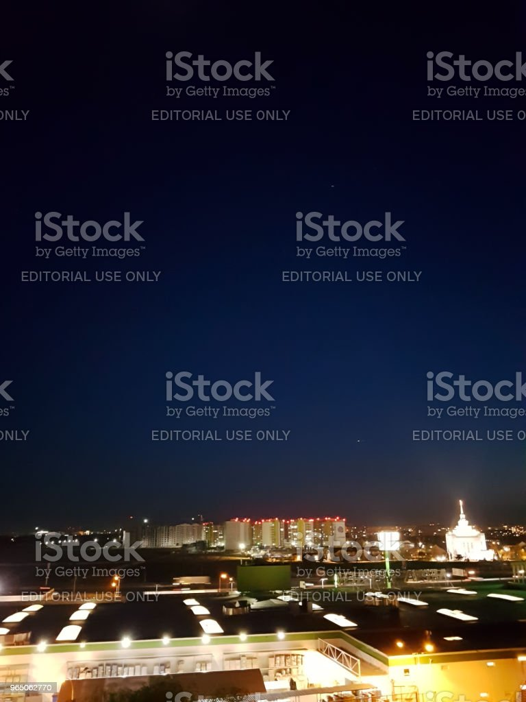 Kiev, Ukraine - May, 29: Borshchagovka district at night in lanterns, shop Novus and Leroy Merlin with a view of the church royalty-free stock photo