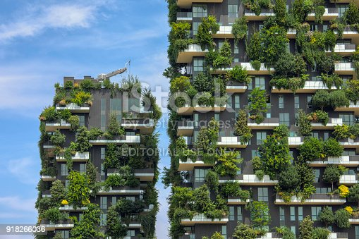 Close up of Bosco Verticale (Vertical Forest) in Milan, two modern residential towers known for its unique inclusion of plants and trees in the design of the building. The towers were completed in 2014.