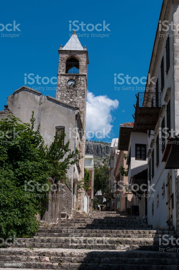 Bosnia: view of the Clock Tower (Sahat Kula), important example of the prolific Ottoman period, dated 1630, bombed and damaged during the Bosnian War (1992-1995) stock photo