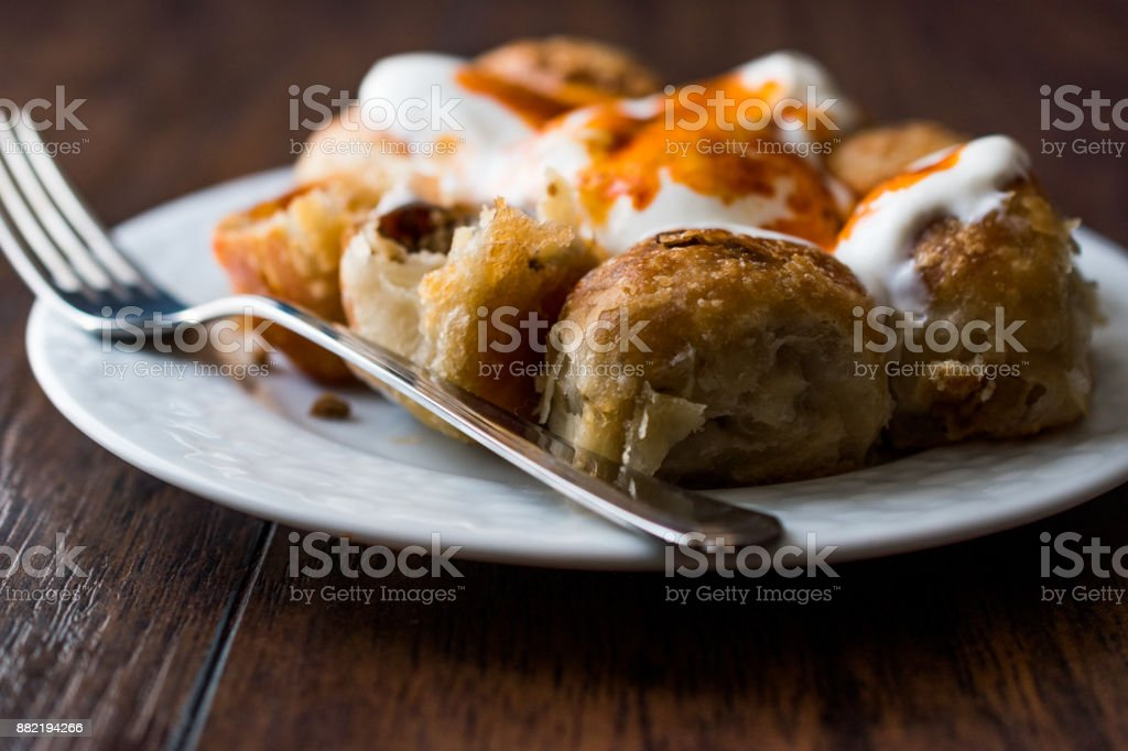 Bosnian Pastry Manti with Yogurt and Fried Butter Sauce / Bosnak Borek stock photo