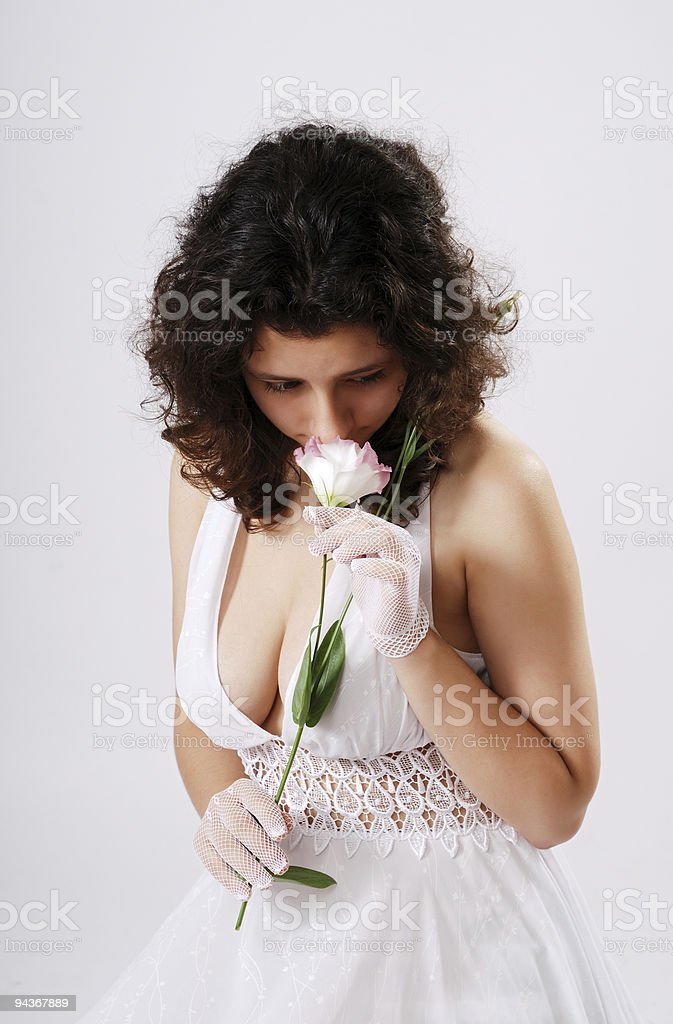 Bosomy girl in low-necked dress. stock photo