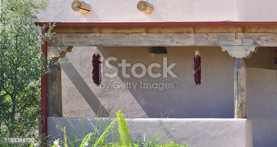 A view of a classic southwestern adobe structure i Bosque del Apache with ristras hanging from the vigas on a stucco building, combined just screams New Mexico architecture. You can put your own name on this one
