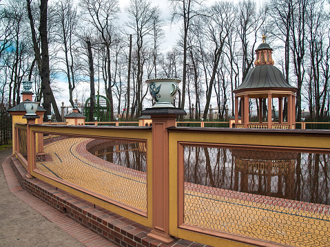 """Bosquet """"Menagerium pond"""" in the Summer Garden in the early spring in April in St. Petersburg"""