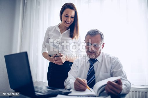 672116416istockphoto Boss and his secretary 537415032