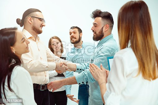 815703312 istock photo Boss approving and congratulating young successful employee 1131170538
