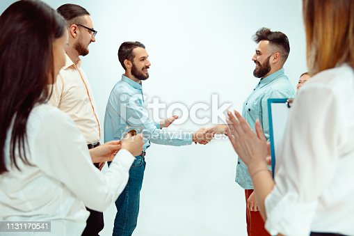 815703312 istock photo Boss approving and congratulating young successful employee 1131170541