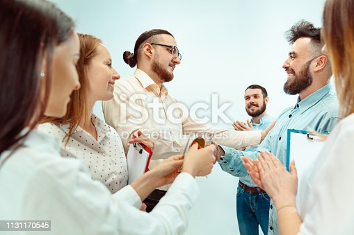815703312 istock photo Boss approving and congratulating young successful employee 1131170545