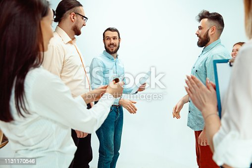 815703312 istock photo Boss approving and congratulating young successful employee 1131170546