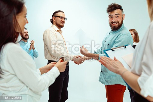 815703312 istock photo Boss approving and congratulating young successful employee 1131170554