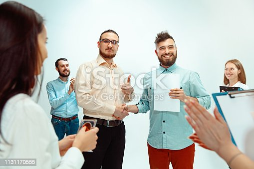 815703312 istock photo Boss approving and congratulating young successful employee 1131170555