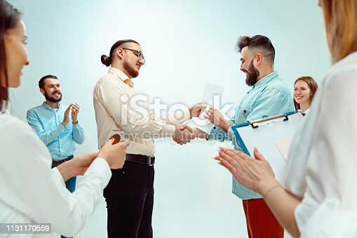 815703312 istock photo Boss approving and congratulating young successful employee 1131170559