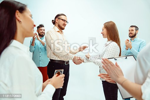 815703312 istock photo Boss approving and congratulating young successful employee 1131170563
