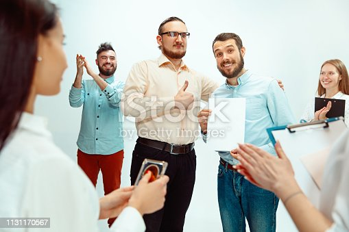 815703312 istock photo Boss approving and congratulating young successful employee 1131170567