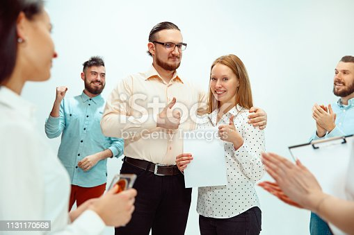 815703312 istock photo Boss approving and congratulating young successful employee 1131170568