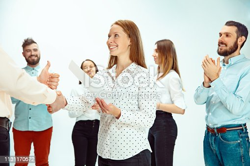 815703312 istock photo Boss approving and congratulating young successful employee 1131170572