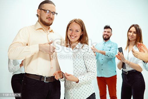 815703312 istock photo Boss approving and congratulating young successful employee 1131170576