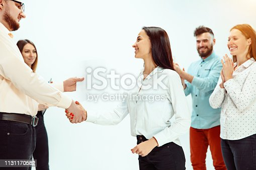 istock Boss approving and congratulating young successful employee 1131170582