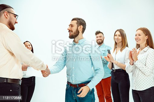 istock Boss approving and congratulating young successful employee 1131170584