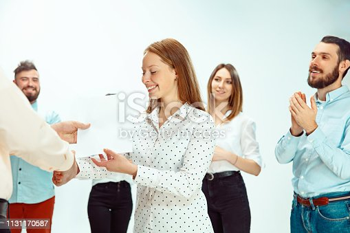 istock Boss approving and congratulating young successful employee 1131170587