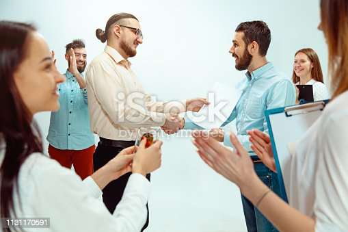 815703312 istock photo Boss approving and congratulating young successful employee 1131170591