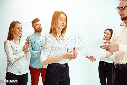 815703312 istock photo Boss approving and congratulating young successful employee 1131170602