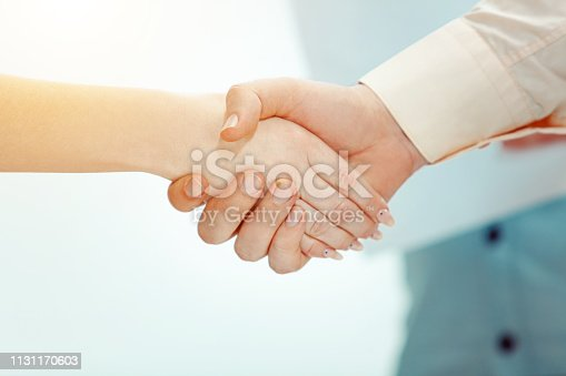 815703312 istock photo Boss approving and congratulating young successful employee 1131170603