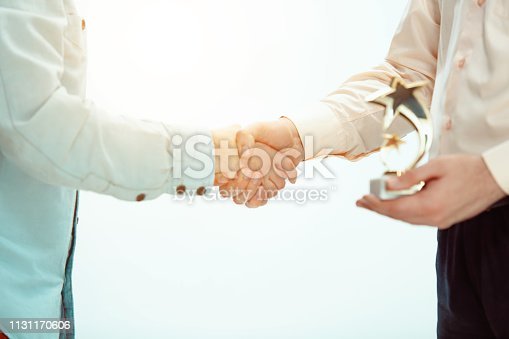815703312 istock photo Boss approving and congratulating young successful employee 1131170606